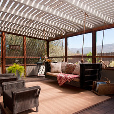 Eclectic Porch by Vintage Porch Swings LLC