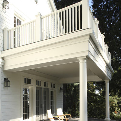Inspiration for a timeless porch remodel in Portland with a roof extension