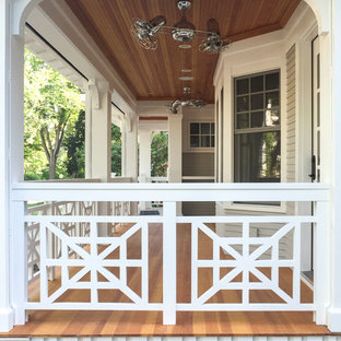 Inspiration for a mid-sized craftsman stone screened-in front porch remodel in Minneapolis with a roof extension