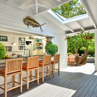 Inspiration for a mid-sized timeless outdoor kitchen porch remodel in Miami with decking and a roof extension