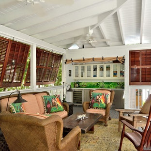Mid-sized island style outdoor kitchen porch idea in Miami with decking and a roof extension