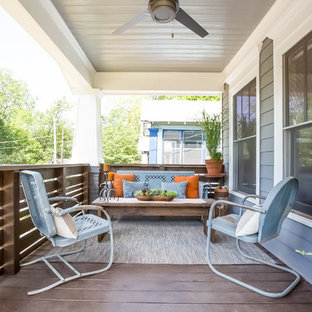 Inspiration for a craftsman front porch remodel in Atlanta with decking and a roof extension