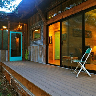 Mountain style porch photo in Austin with decking