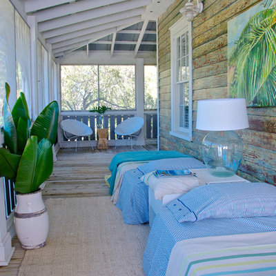 Beach style porch photo in Jacksonville with a roof extension