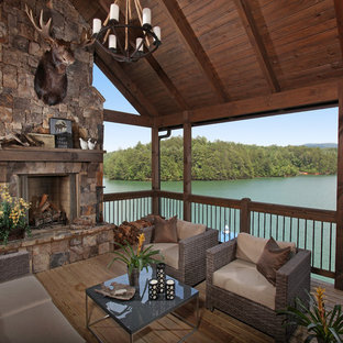 Inspiration for a mid-sized rustic back porch remodel in Atlanta with a fire pit, decking and a roof extension