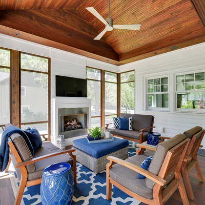 Mid-sized beach style screened-in side porch idea in Minneapolis with decking and a roof extension