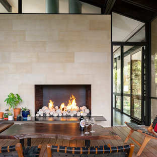 Mountain style screened-in porch idea in Austin with decking and a roof extension