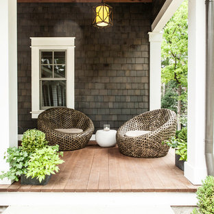 Inspiration for a large timeless back porch remodel in Milwaukee with decking and a roof extension