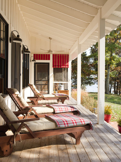 Luxury Farmhouse Porch by Gridley Graves Photographers