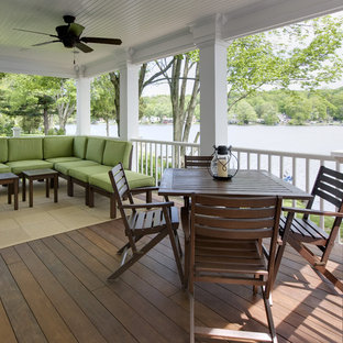 Inspiration for a timeless porch remodel in New York with decking