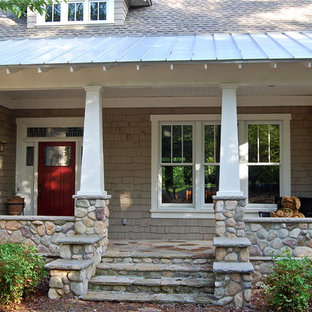 This is an example of a traditional stone porch design in Other with a roof extension.