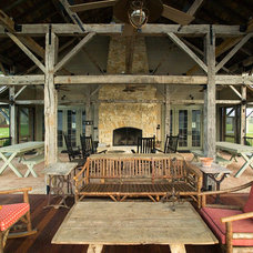Rustic Porch by Sheffield Construction Company, Inc