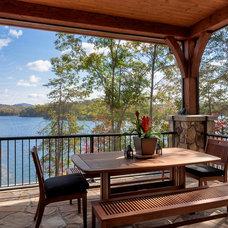 Rustic Porch by Ridgeline Construction Group, Inc