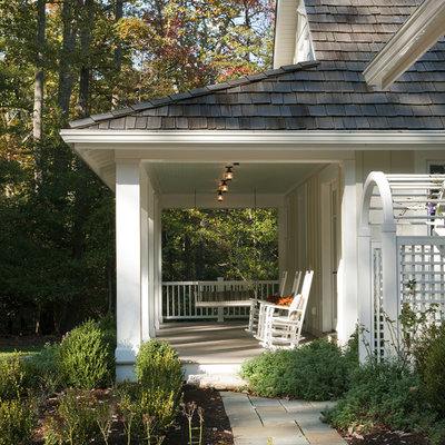 This is an example of a coastal porch design in DC Metro with a roof extension.