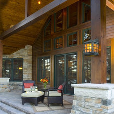 rustic porch by Gabberts Design Studio