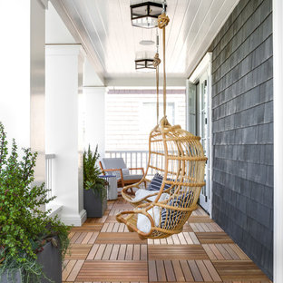 Inspiration for a beach style porch container garden remodel in Los Angeles with decking and a roof extension