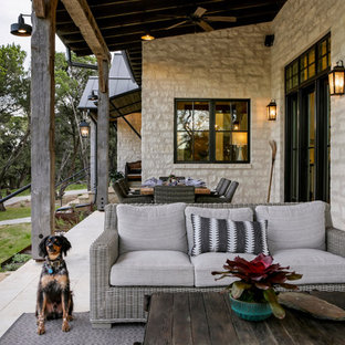 Mountain style porch idea in Austin with a roof extension
