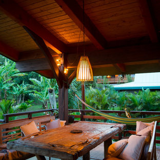 Island style porch idea in Hawaii with a roof extension