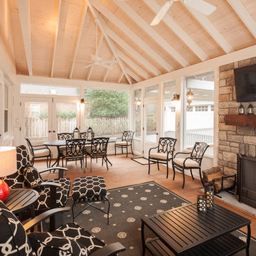 Light and airy screened porch with stone veneered fireplace
