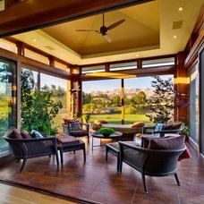 Transitional Porch by Michael Sagouspe Design, Inc