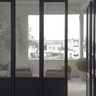 Idee per un portico industriale con un portico chiuso e cemento stampato