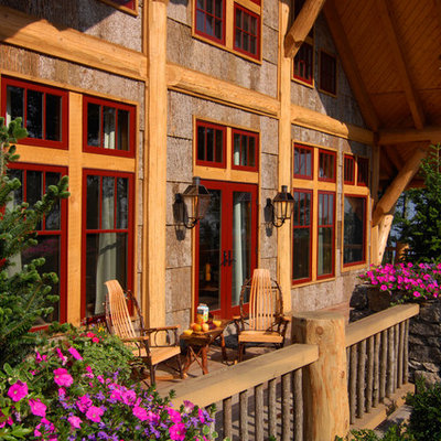 Inspiration for a large rustic front porch remodel in Charlotte with decking and a roof extension