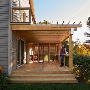 Idee per un patio o portico minimalista di medie dimensioni e nel cortile laterale con un portico chiuso e una pergola