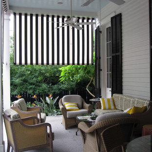 Elegant Porch Photo In New Orleans With A Roof Extension