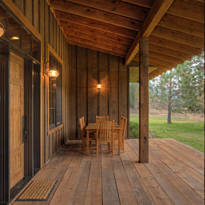 This is an example of a mid-sized rustic porch design in Seattle.