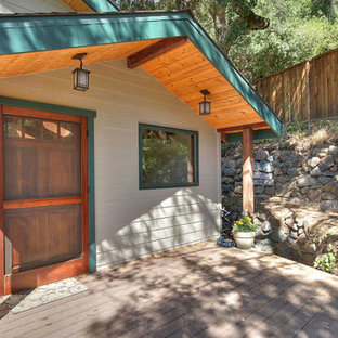 Mid-sized mountain style back porch photo in San Francisco with a roof extension
