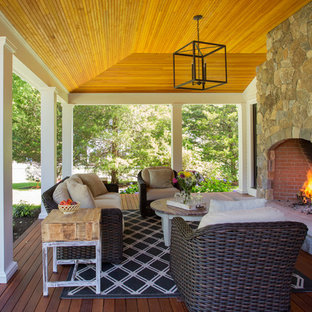 Large cottage back porch idea in Boston with a fire pit, a roof extension and decking