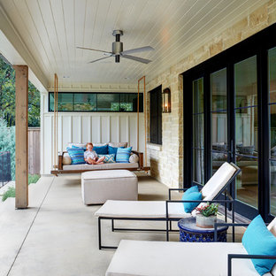 Large cottage concrete side porch idea in Austin with a roof extension