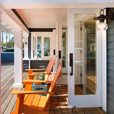 Mid-sized beach style front porch photo in San Diego with decking and a roof extension