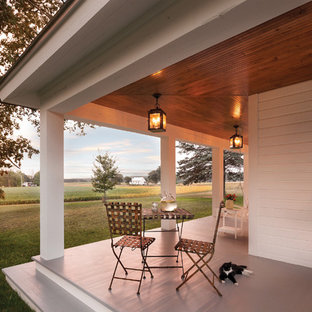 Country porch photo in Other with a roof extension