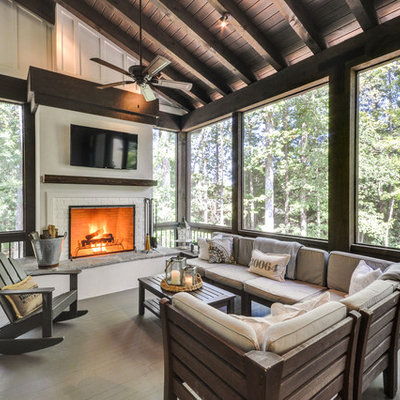 This is an example of a cottage screened-in porch design in Atlanta with decking and a roof extension.