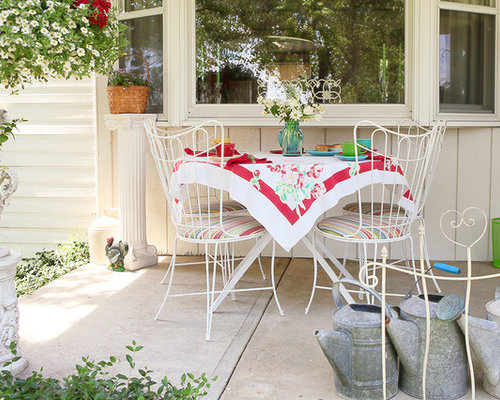 This Is An Example Of A Shabby Chic Style Concrete Porch Design In Columbus.