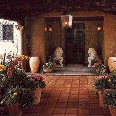 Mediterranean Porch by GH garden designs