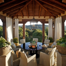 Mediterranean Porch by Giffin & Crane General Contractors, Inc.