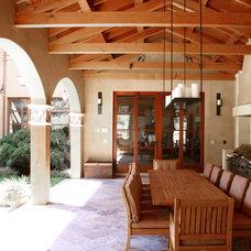Mediterranean Porch by Polsky Perlstein Architects