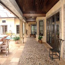 Mediterranean Porch by Cote Renard Architecture
