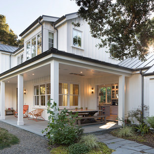Mid-sized farmhouse stone side porch photo in San Francisco with a roof extension