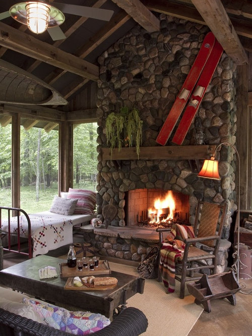 cabin with fireplace. This is an example of a rustic porch design in Minneapolis with fire pit  and Cabin Fireplace Houzz