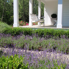 farmhouse porch by Landscape Design Services