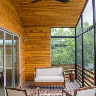 Trendy porch idea in Austin with decking and a roof extension