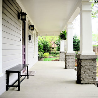 Arts and crafts front porch idea in Charlotte with a roof extension