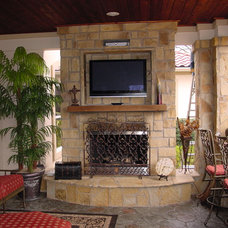 Mediterranean Porch by Angler Remodeling and Exteriors