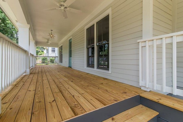 Farmhouse Porch by Level Craft Construction