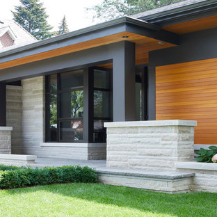 Mid Sized Minimalist Stone Porch Photo In Toronto With A Roof Extension