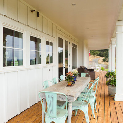 Large country front porch photo in Portland with decking and a roof extension