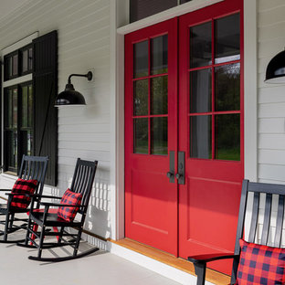 Large farmhouse front porch idea in Boston with decking and a roof extension